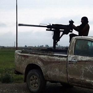 Iraqi forces push toward Tikrit, with help