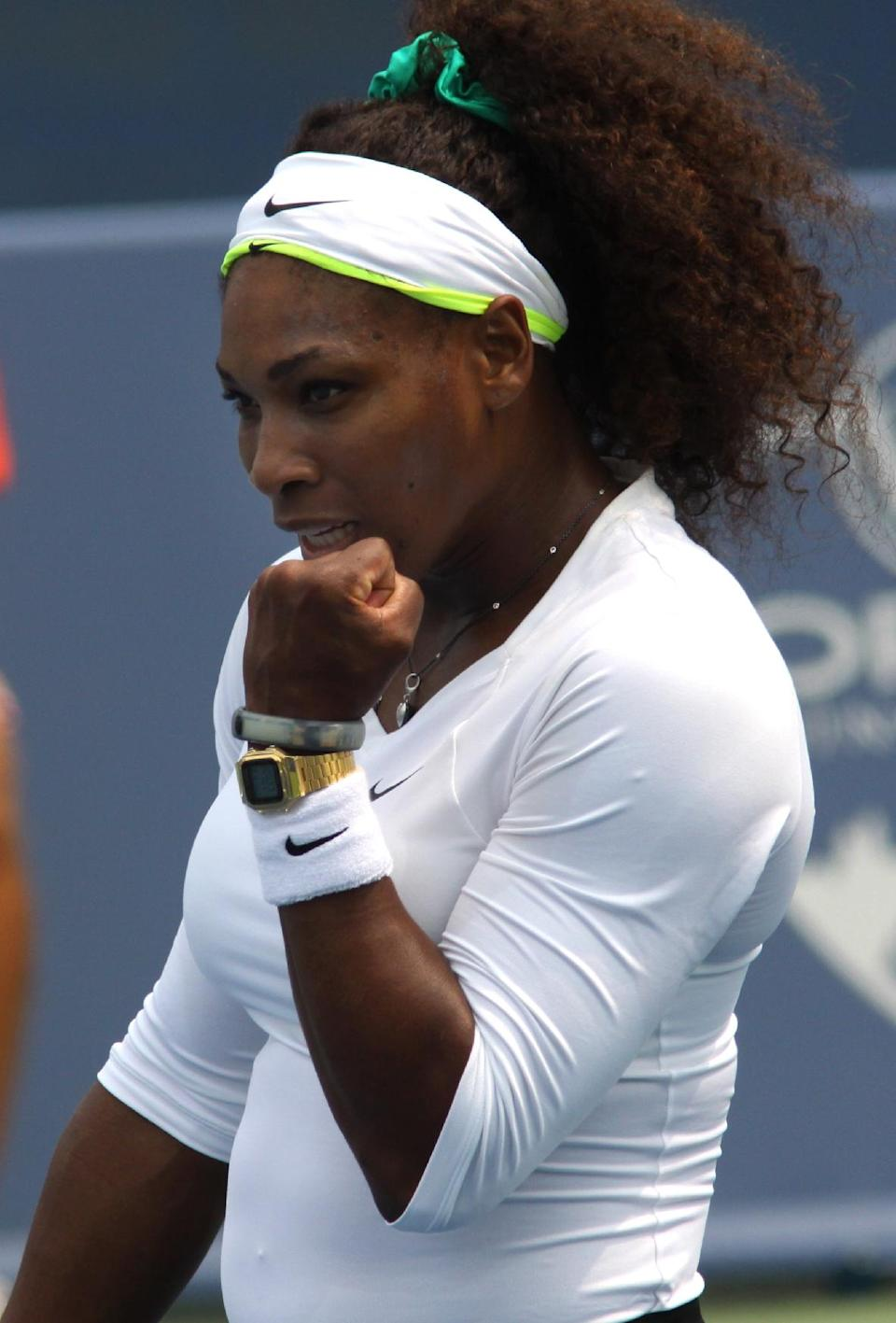 Serena Williams, of the United, reacts after beating Urszula Radwanska, of Poland, after a match at the Western & Southern Open tennis tournament, Thursday, Aug. 16, 2012, in Mason, Ohio. (AP Photo/Tom Uhlman)