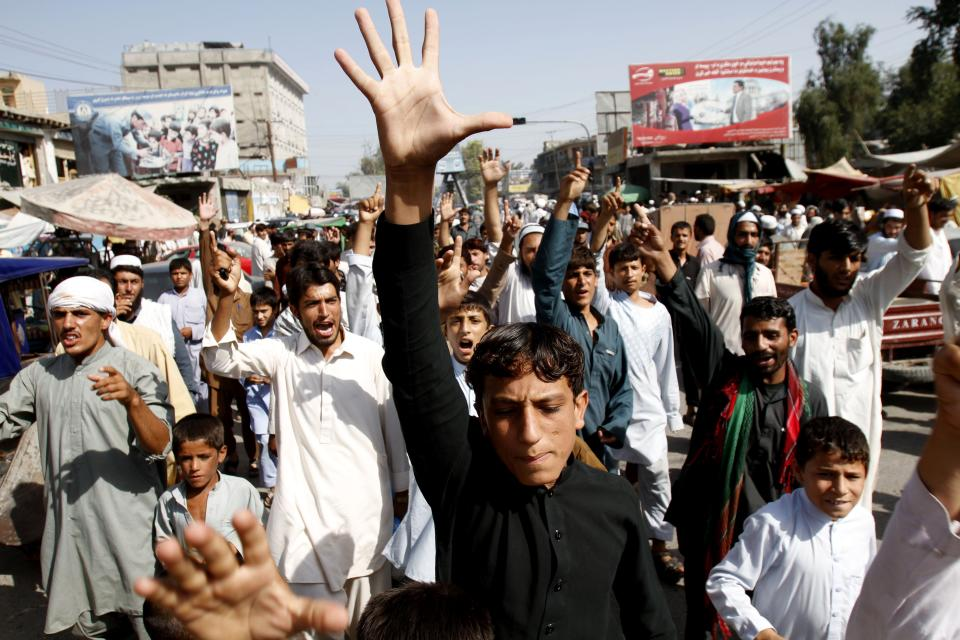 Afghans shout anti-U.S. slogans in the city of Jalalabad, east of Kabul, Afghanistan, Saturday, Sept. 15, 2012 during a protest against an anti-Islam film which depicts the Prophet Muhammad as a fraud, a womanizer and a madman. (AP Photo/Rahmat Gul)