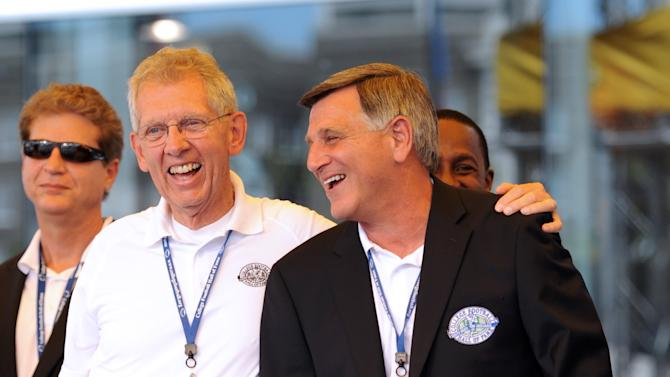 Coach Bill Manlove from, Widener, Delaware Valley and LaSalle, left, smiles with Mike Kelly, Dayton 1981-2007, after Kelly received his blazer during the College Football Hall of Fame Enshrinement Festival in South Bend, Ind., on Saturday, July 16, 2011. (AP Photo/Joe Raymond)