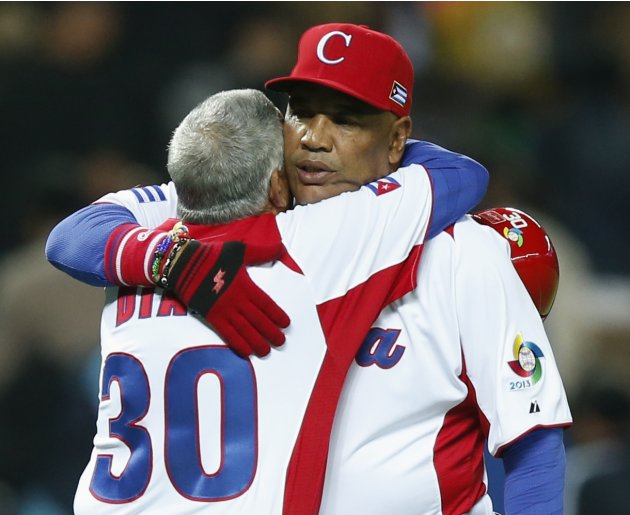 Cuba's manager Mesa celebrates with coach Diaz after defeating Japan at the World Baseball Classic qualifying first round in Fukuoka