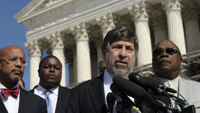 """FILE - In this Oct. 15, 2013, file photo, Mark Rosenbaum, second from right, of the American Civil Liberties Union, speaks to reporters after arguing their case before the Supreme Court in Washington. The Republican Party is hiring people to reach out to black and Hispanic communities, and setting goals for the number of minority candidates it will recruit. At the same time, Republican judges are moving closer to a long-held conservative goal of ending affirmative action. Rosenbaum, who argued the case on behalf of minority groups that opposed the affirmative action ban, said the sort of routine outreach that political parties perform is prohibited to public universities under laws like Michigan's. """"They can say, 'If you're a person of color, you would not feel out of place in our party,'"""" Rosenbaum said. """"But if a university said that, there would be 1,000 lawsuits tomorrow."""" (AP Photo/Susan Walsh, File)"""