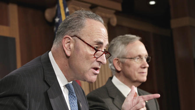 Sen. Charles Schumer, D-N.Y., left, accompanied by Senate Majority Leader Harry Reid of Nev., gestures during a news conference on Capitol Hill in Washington, Wednesday, Aug. 3, 2011, to talk about the need to overcome the partisan standoff over a bill to end the partial shutdown of the Federal Aviation Administration (FAA).  (AP Photo/J. Scott Applewhite)
