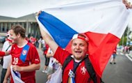 Czech Republic's fans react after arriving in a special train from Prague to Warsaw ahead of their Euro 2012 quarter-final match against Portugal in Warsaw