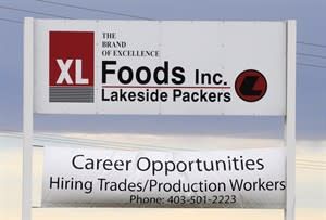 Main entrance sign for XL Foods' Lakeside Packers plant at Brooks, Alberta on Oct. 1st, 2012, 2012. THE CANADIAN PRESS/Larry MacDougal