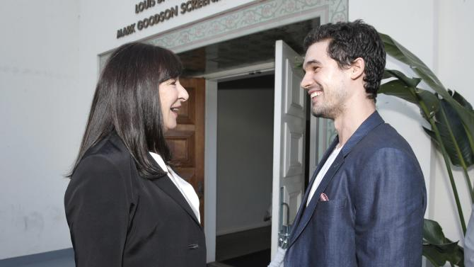 """Anjelica Huston, left, and Steven Strait arrive at the """"Magic City"""" season 2 premiere at the American Film Institute on Monday, June 3, 2013, in Los Angeles. (Photo by Todd Williamson/Invision for Starz/AP Images)"""