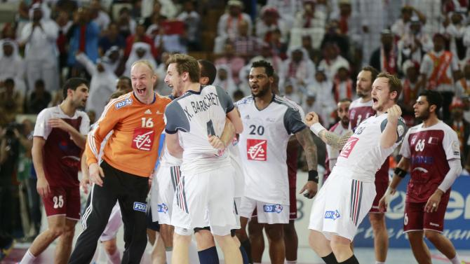 France's players celebrates winning their final match against Qatar of the 24th Men's Handball World Championship in Doha