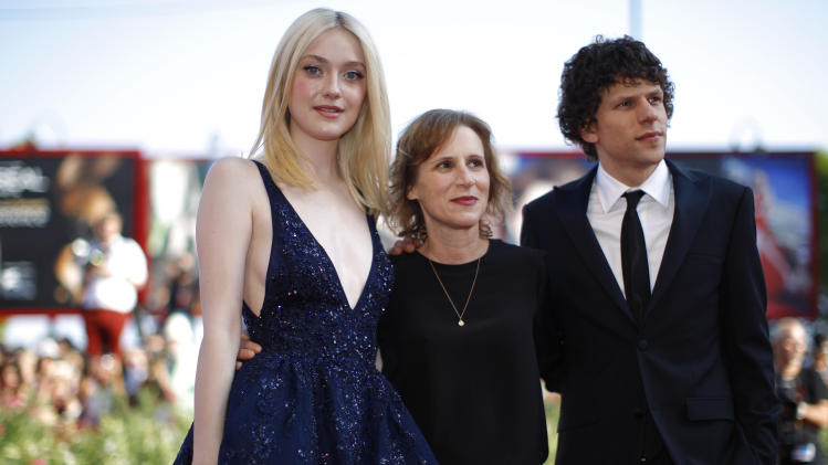 Actress Dakota Fanning, director Kelly Reichardt and actor Jesse Eisenberg pose for photographers on the red carpet for the screening of the film Night Moves at the 70th edition of the Venice Film Festival held from Aug. 28 through Sept. 7, in Venice, Italy, Saturday, Aug. 31, 2013. (AP Photo/Andrew Medichini)