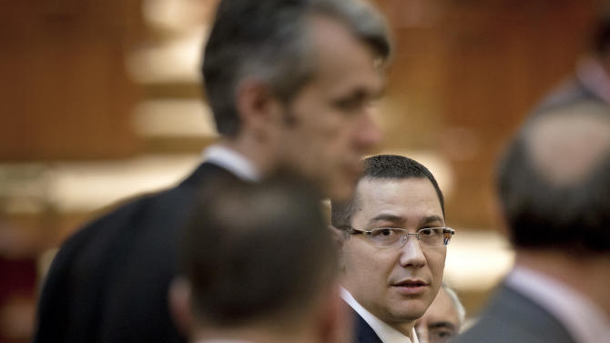 Romanian Premier designate Victor Ponta, right, is seen before a parliament session in Bucharest, Romania, Monday, May 7, 2012. Romanian lawmakers are voting on whether to approve the prime minister designate's left-leaning Cabinet, which is expected to continue a slate of economic reforms. (AP Photo/Vadim Ghirda)