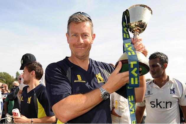 Ashley Giles, centre, won the LV= County Championship with Warwickshire this summer