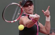 Australia&#39;s Samantha Stosur hits a return to Russia&#39;s Nadia Petrova during their women&#39;s singles match of the French Open tennis tournament at the Roland Garros stadium in Paris. Stosur won 6-3, 6-3