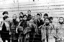 "A picture taken just after the liberation by the Soviet army in January, 1945, shows a group of children wearing concentration camp uniforms behind barbed wire fencing in the Auschwitz Nazi concentration camp. On Thursday Jan. 22, 2015, Russia accused Poland of engaging in a ""mockery of history"" after the Polish foreign minister Grzegorz Schetyna credited Ukrainian soldiers, rather than the Soviet Red Army, with liberating Auschwitz 70-years ago. The latest exchange comes prior to the 70th anniversary of the liberation of Auschwitz by Soviet troops on Jan. 27, 1945, underlining deep tensions between Russia and Poland, which is hugely critical of Russia's recent actions in Ukraine. (AP Photo/FILE)"