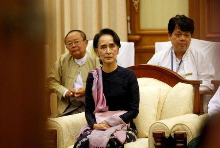 Myanmar's National League for Democracy leader Aung San Suu Kyi sits in meeting room after opening of the new upper house of parliament in Naypyitaw