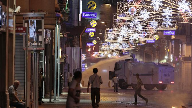 A police water canon sprays protesters during clashes near Taksim Square in Istanbul, Turkey, Saturday, June 22, 2013. (AP Photo/Petr David Josek)
