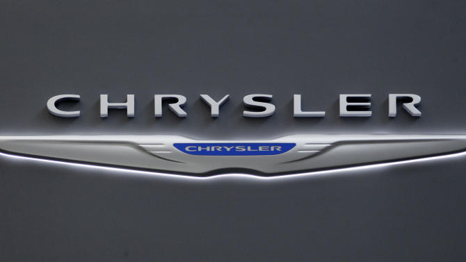 FILE - This Feb. 16, 2012 photo shows Chrysler logo on the Chrysler exhibit at the 2012 Pittsburgh Auto Show.   Chrysler says its U.S. sales rose 13 percent in July on strong demand for the Chrysler 200 sedan and other models. Chrysler says it sold more than 126,000 new cars and trucks last month, the company's best July in five years. Sales of its best-selling Ram pickup rose 17 percent as home building increased. Sales of the 200 rose 43 percent. The company's sales increase was slightly above expectations for overall industry growth of about 11 percent. Car companies report U.S. sales throughout the day on Wednesday.(AP Photo/Gene J. Puskar)