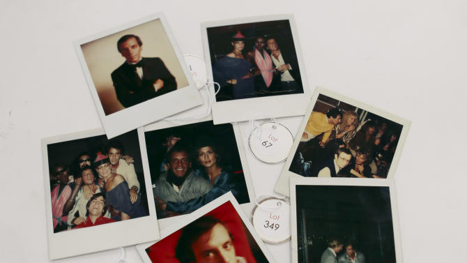 This Jan. 16, 2013 photo shows various polaroids shot by Andy Warhol at Studio 54 on display in West Palm Beach, Fla. Memorabilia from the famed 1970s club is hitting the auction block in Florida. The private collection of co-founder Steve Rubell is being sold Saturday in West Palm Beach. (AP Photo/Alan Diaz)
