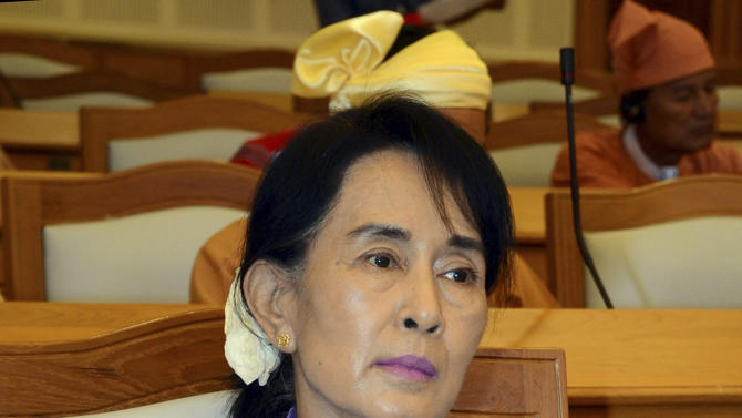FILE - In this Oct. 22, 2012 file photo, Myanmar Opposition leader Aung San Suu Kyi takes a seat to attend a regular session at Myanmar Union Parliament in Naypyitaw, Myanmar. The nation's warp-speed revolution remains fragile, its transition sometimes bloody, and there are concerns President Barack Obama's trip, aimed at encouraging democracy, may be premature. Harsh laws that helped silence a generation of pro-democracy dissidents remain in place, and the power structure is still tipped heavily in favor of army rule. (AP Photo/Khin Maung Win, File)
