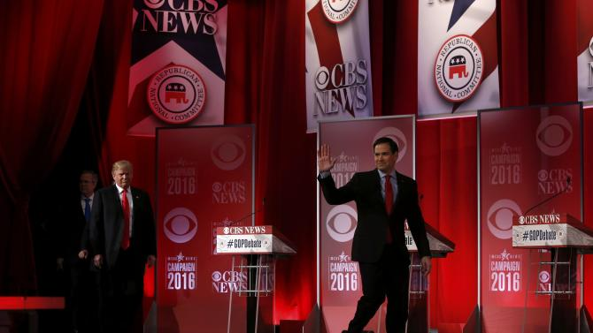 Republican U.S. presidential candidates Rubio, Trump and Bush take the stage before the start of the Republican U.S. presidential candidates debate sponsored by CBS News and the Republican National Committee in Greenville