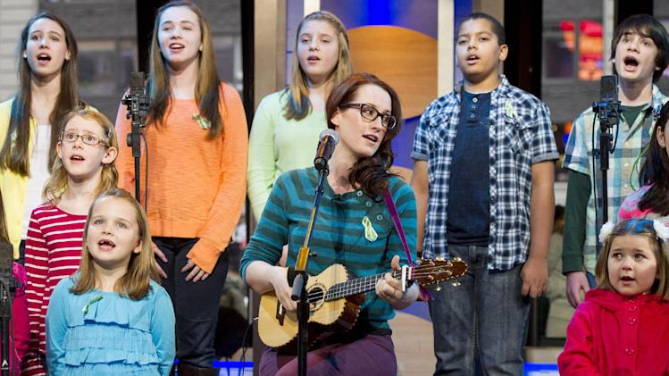 "Ingrid Michaelson accompanied by children from Newtown, Conn. and Sandy Hook Elementary school perform ""Somewhere Over the Rainbow"" on ABC's ""Good Morning America"" on Tuesday, Jan. 15, 2013 in New York. (Photo by Charles Sykes/Invision/AP)"