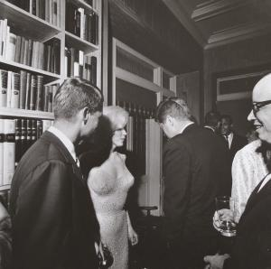 "This photo provided by Bonhams auction house, by former White House photographer Cecil Stoughton, shows Marilyn Monroe with President John F. Kennedy, center, and Robert Kennedy, left, at a Democratic fundraiser on May 19, 1962 at a home in New York City. Monroe had come straight from Madison Square Garden where she had sung ""Happy Birthday"" to the president.  It is one of a trove of JFK photos being offered by Stoughton's estate at Bonhams auction house in New York, Thursday, Dec. 9, 2010. (AP Photo/Bonhams, Cecil Stoughton) NO SALES"