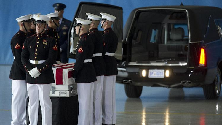 A carry team stands by the flag draped transfer case containing the remains of one of the Americans killed this week in Benghazi, Libya, during a Transfer of Remains Ceremony, Friday, Sept. 14, 2012, at Andrews Air Force Base, Md., marking the return to the United States of the remains of the four Americans killed this week in Benghazi, Libya. (AP Photo/Carolyn Kaster)