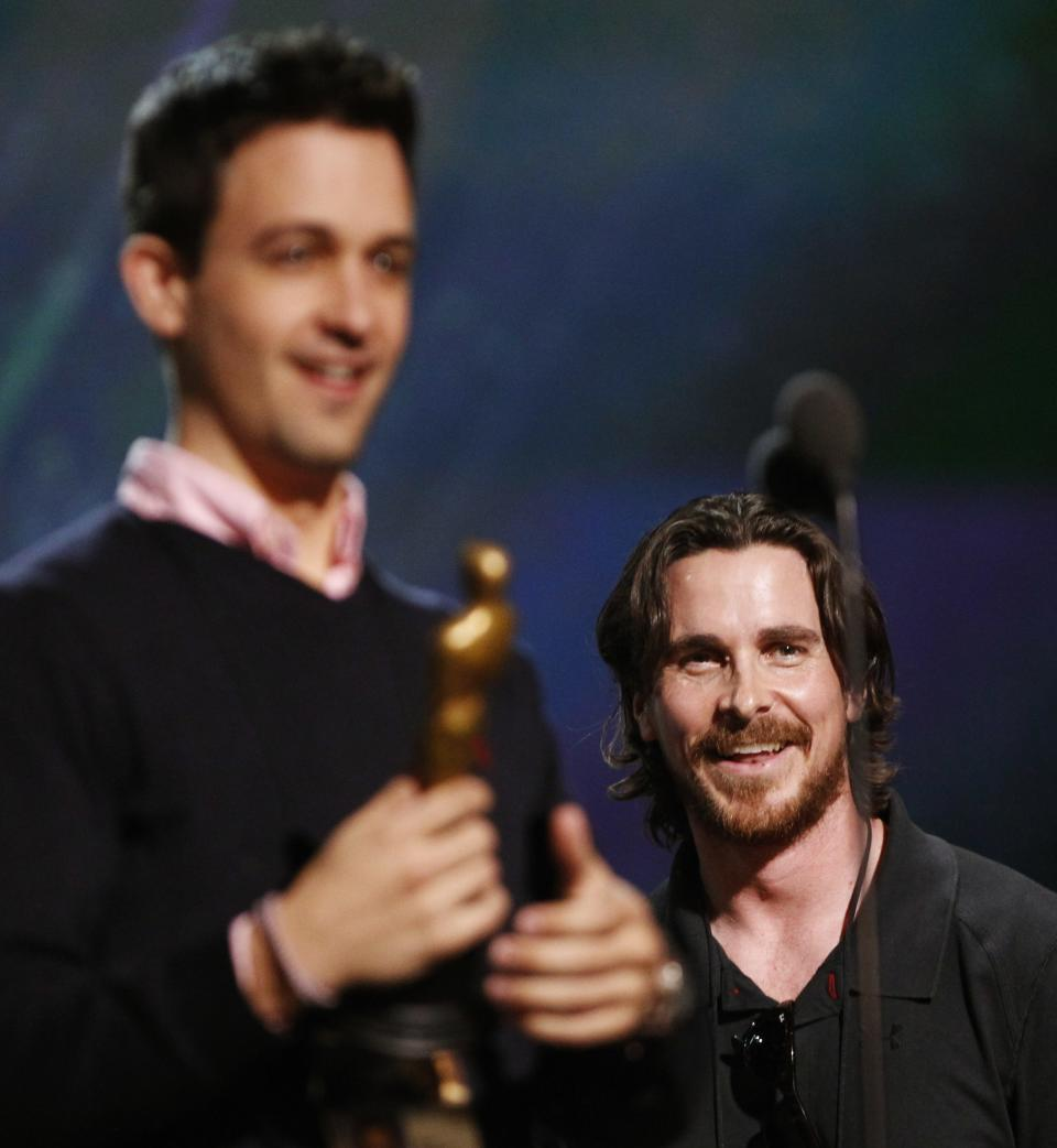 Actor Christian Bale, center, reacts to actor Sean Stewart, while preparing for the 84th Academy Awards, Saturday, Feb 25, 2012 in Los Angeles. (AP Photo/Chris Carlson)