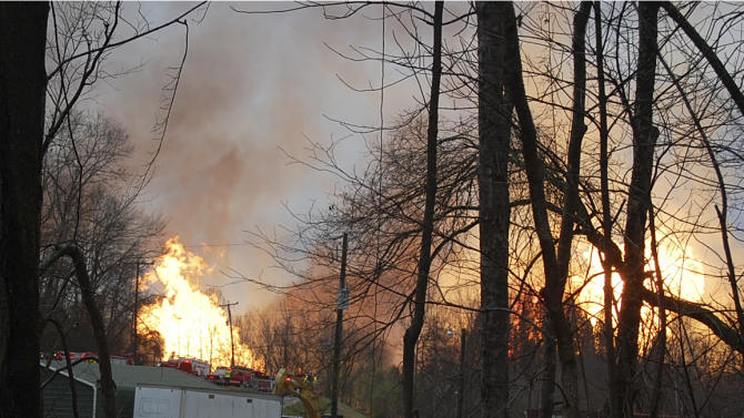 Flames from a gas line explosion cross Interstate 77 near Sissonville, W.Va., Tuesday, Dec. 11, 2012. West Virginia State Police say several structures are on fire and about a mile of Interstate 77 is shut down in both directions.  (AP Photo/Joe Long)   MAGS OUT