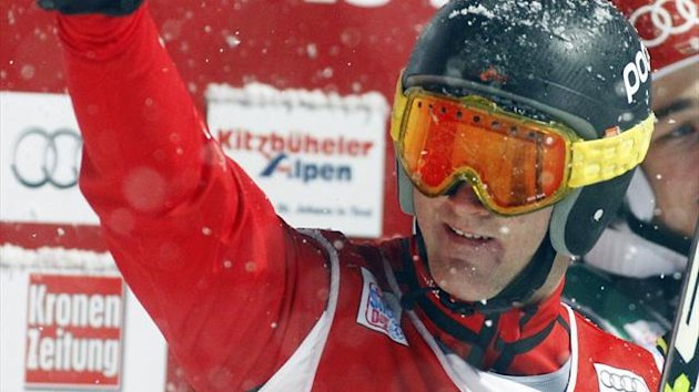 Switzerland's Alex Fiva clebrates after winning the FIS men's skicross world cup event