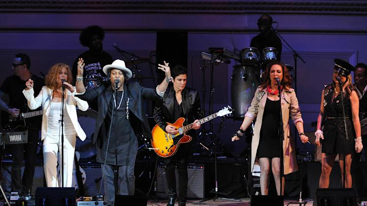 "Singer D'Angelo, left, performs with Wendy Melvoin, Maya Rudolph and Gretchen Lieberum at ""The Music of Prince"" tribute concert at Carnegie Hall on Thursday March 7, 2013 in New York. (Photo by Evan Agostini/Invision/AP)"