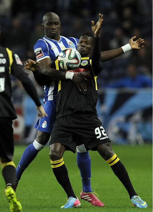FC Porto's Eliaquim Mangala, left, from France challenges Arouca's Salim Cisse, from Guinea Conakry, in a Portuguese League soccer match at the Dragao stadium, in Porto, Portugal, Sunday March