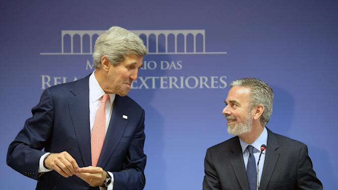 U.S. Secretary of State John Kerry, left, and Brazil's Foreign Minister Antonio de Aguiar Patriota give a press conference at Itamaraty palace in Brasilia, Brazil, Tuesday, Aug. 13, 2013. Patriota criticized U.S. surveillance in Brazil and said the trust between the U.S. and Brazil would be damaged if U.S. explanations about the program are not satisfactory. (AP Photo/Evaristo Sa, Pool)