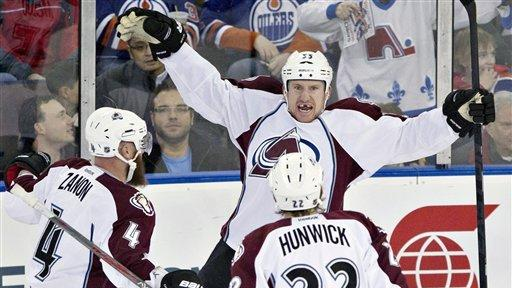 Oilers use team-record 56 shots to beat Avs 6-4