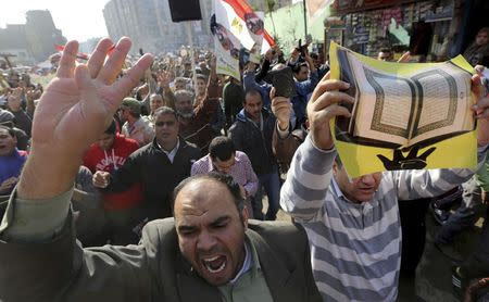 People shout slogans against the military and interior ministry during an Islamist protest in the Cairo suburb of Matariya