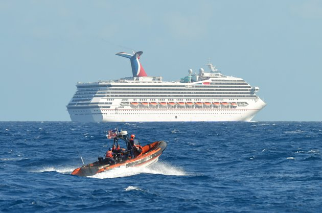 <p>               In this image released by the U.S. Coast Guard on Feb. 11, 2013, a small boat belonging to the Coast Guard Cutter Vigorous patrols near the cruise ship Carnival Triumph in the Gulf of Mexico, Feb. 11, 2013. The Carnival Triumph has been floating aimlessly about 150 miles off the Yucatan Peninsula since a fire erupted in the aft engine room early Sunday, knocking out the ship's propulsion system. No one was injured and the fire was extinguished. (AP Photo/U.S. Coast Guard- Lt. Cmdr. Paul McConnell)