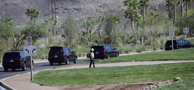 Motorcade vehicles for President Barack Obama are seen leaving the Lake Las Vegas resort en route to a local campaign office, Monday, Oct. 1, 2012, in Henderson, Nev. Sometimes all President Barack Obama has to do is look out the window to get a first-hand look at the country's economic woes. This week in this town, the presidential motorcade speeds past opulent homes lining manmade Lake Las Vegas as he heads to the sprawling luxury development where he's preparing for the upcoming debates with Mitt Romney. But many houses here are empty, victims of Nevada's foreclosure crisis, and others are worth far less than their purchase price. (AP Photo/Pablo Martinez Monsivais)