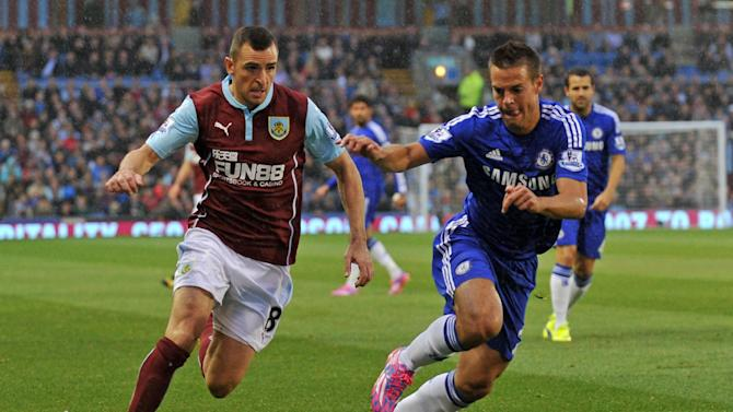 Burnley's Dean Marney (L) fights for the ball with Chelsea's Cesar Azpilicueta during their English Premier League match, at Turf Moor in Burnley, north-west England, on August 18, 2014