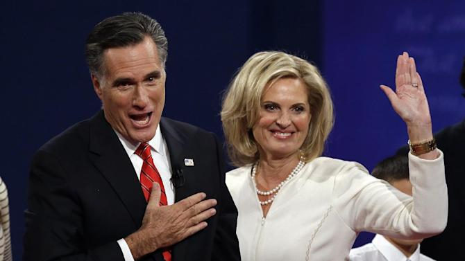 Republican presidential nominee Mitt Romney  and with wife Ann wave toward the audience after the first presidential debate at the University of Denver, Wednesday, Oct. 3, 2012, in Denver. (AP Photo/Charlie Neibergall)