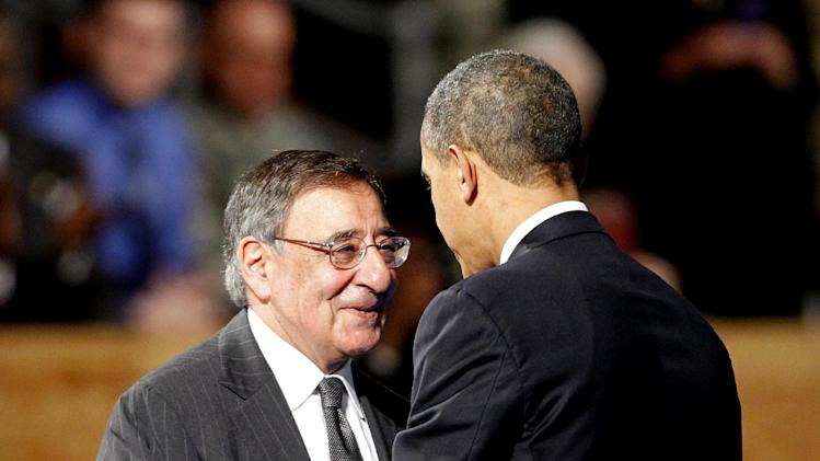 President Barack Obama embraces outgoing Defense Secretary Leon Panetta during an Armed Forces Farewell Ceremony to honor Panetta, Friday, Feb. 8, 2013, at Joint Base Myer-Henderson Hall in Arlington, Va. (AP Photo/Ann Heisenfelt)