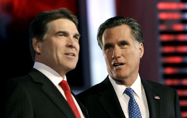 Republican presidential candidates, Texas Gov. Rick Perry, left and, former Massachusetts Gov. Mitt Romney, right, talk prior to the Republican debate, Saturday, Dec. 10, 2011, in Des Moines, Iowa. (AP Photo/Charlie Neibergall)