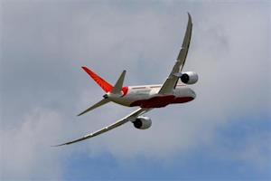An Air India Airlines Boeing 787 dreamliner, takes part in a flying display during the 50th Paris Air Show, at the Le Bourget airport near Paris