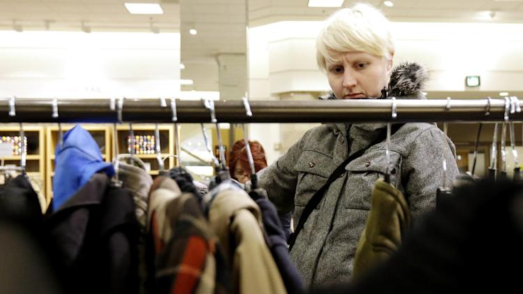In this Thursday, Jan. 20, 2013, photo, a woman shops at a Nordstrom store in Chicago. U.S. consumer confidence plunged in January to its lowest level in more than a year, reflecting higher Social Security taxes that left Americans with less take-home pay.  (AP Photo/Nam Y. Huh)