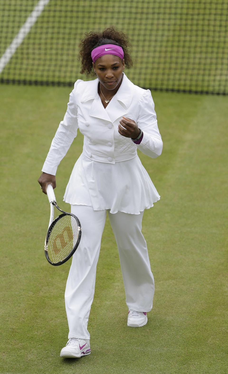 Serena Williams of the United States prepares for a fourth round women's singles match against Yaroslava Shvedova of Kazakhstan at the All England Lawn Tennis Championships at Wimbledon, England, Monday, July 2, 2012. (AP Photo/Kirsty Wigglesworth)