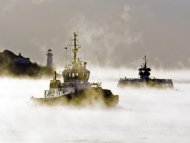 A ferry and tug boat cross the harbour through Arctic sea smoke in Halifax on Monday, Jan. 24, 2011. The evaporation fog occurs when very cold air drifts across relatively warm water. Wind chill warnings are in effect across much of Eastern and Central Canada.