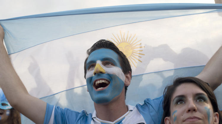 Soccer fans of the Argentina national soccer team cheer during a live telecast of the soccer World Cup semifinal match between Argentina and The Netherlands, inside the FIFA Fan Fest area on Copacabana beach, in Rio de Janeiro, Brazil, Wednesday, July 9, 2014. (AP Photo/Silvia Izquierdo)