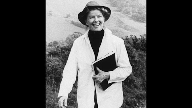 "FILE - Actress Katharine Hepburn strolls down a country lane on location near London during the filming of their made for TV movie, ""The Corn Is Green,"" in this Jan. 23, 1979 file photo. ""The fact that she wore slacks and wanted to be comfortable influenced women's ready-to-wear in the United States,"" said Jean Druesedow, director of the Kent State University Museum, which was given 700 items from Hepburn's estate.   (AP Photo/File)"