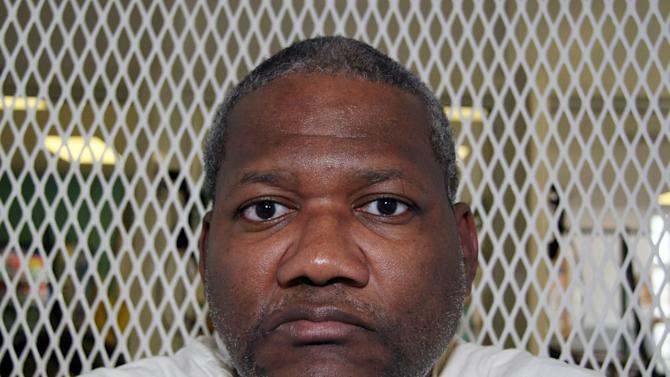 In this Oct. 17, 2012, photo, Texas death row inmate Preston Hughes III speaks from a visiting cage at the Texas Department of Criminal Justice Polunsky Unit outside Livingston, Texas. Hughes is scheduled for lethal injection Nov. 15, 2012, for the 1988 murders in Houston of Shandra Charles, 15, and her 3-year-old cousin, Marcell Taylor. (AP Photo/Michael Graczyk)