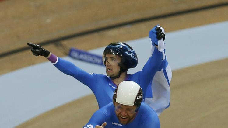 Scotland's Neil Fachie celebrates after winning men's 1000m Time Trial B2 Tandem cycling race at the 2014 Commonwealth Games in Glasgow