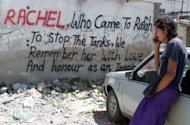 File photo shows graffiti about American activist Rachel Corrie who was killed during a protest in the southern Gaza Strip town of Rafah in 2003. The Israeli military closed its own investigation into the matter in 2003 without taking any disciplinary action, saying the military bulldozer crew could not see Corrie because she was behind a mound of rubble