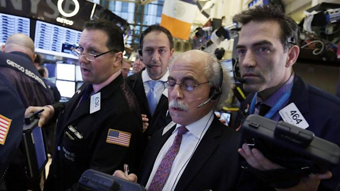 Traders gather at a post on the floor of the New York Stock Exchange Thursday, Jan. 10, 2013. Stocks opened higher on Wall Street Thursday, gaining for a second day, after the European Central Bank chief said the region was poised to start growing again, bolstering expectations that the worst of the region's crisis is behind it. (AP Photo/Richard Drew)