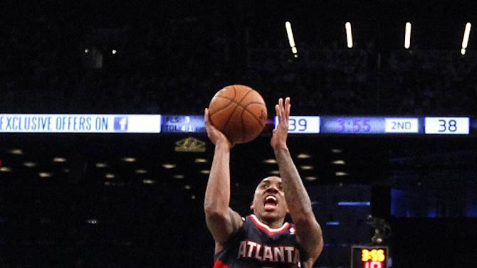 Hawks beat Nets, close in on playoff spot